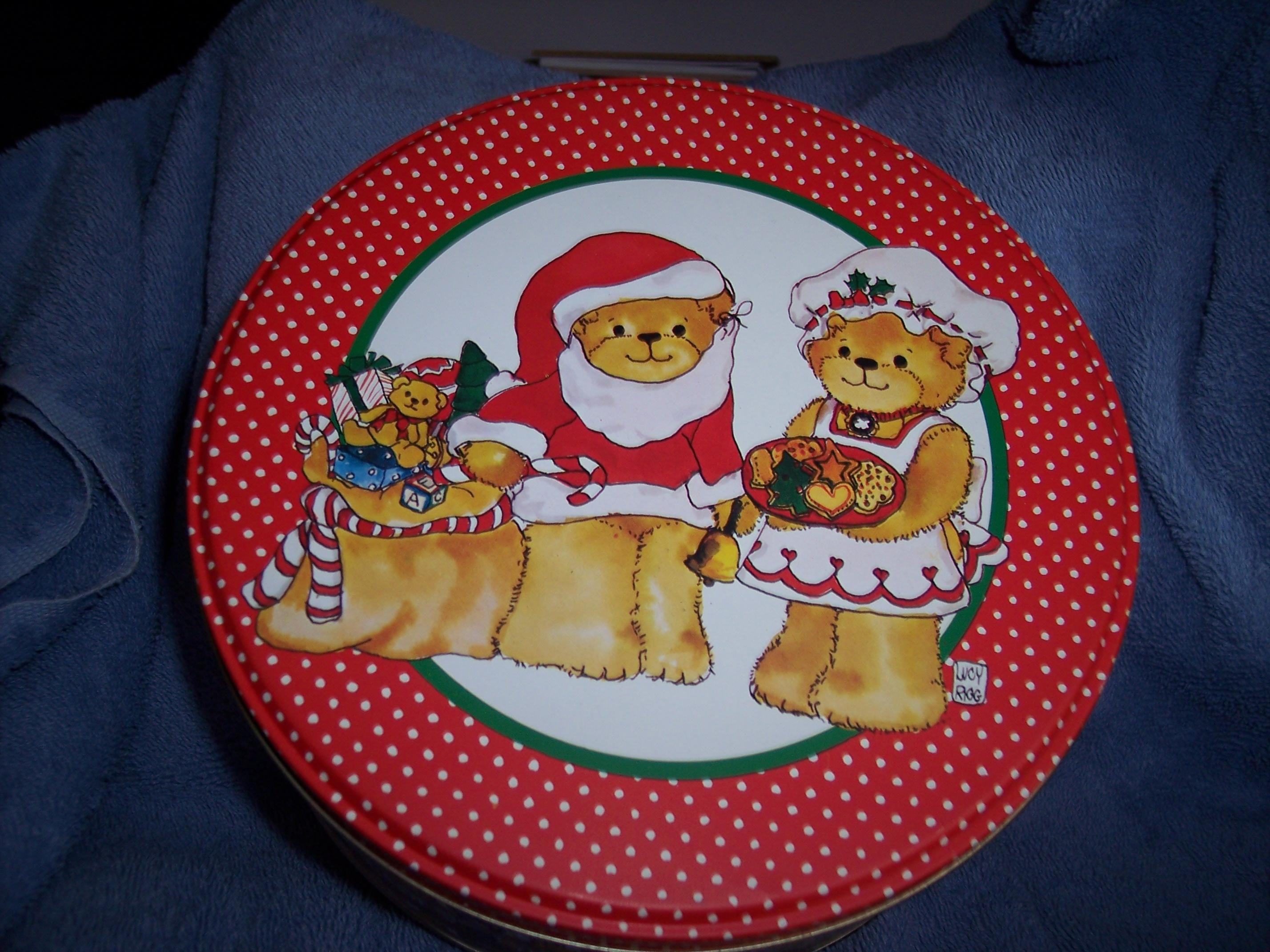 Santa and Mrs. Claus 6 1/2 inch round cookie tin