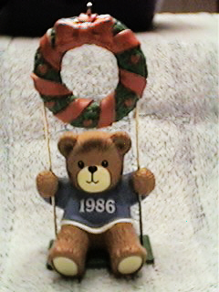 1986 boy in swing ornament H3-3-7