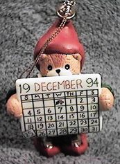 1994 elf holding calendar ornament NP