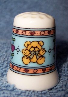 Blue background bear thimble in box