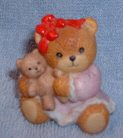 Girl sitting in pink dress & red bow holding teddy bear C6-1-2