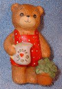 Girl bear watering plant G1-2-5