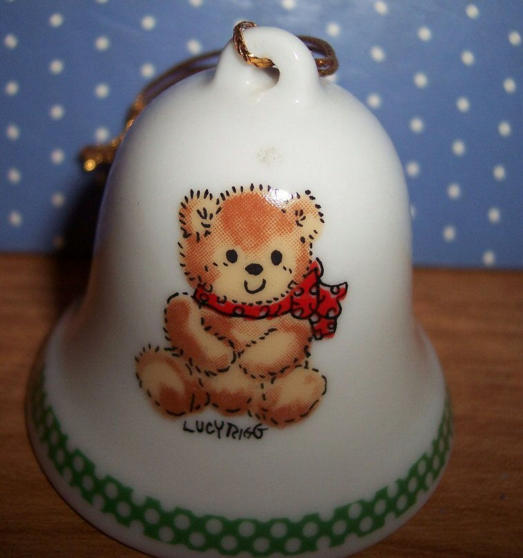 Little bear with green border bell