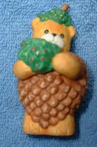 Bear as pinecone holding Christmas tree C8-4-4