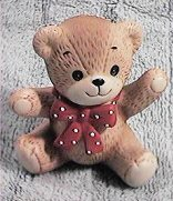 Red bow bear sitting both paws out G1-1-2 +
