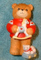 Bear in red shirt holding rocking horse C3-1-3 *** and box 11