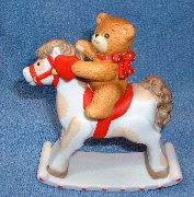 Bear on rocking horse G2-2-3